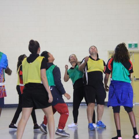 Staff and students enjoying a basketball game.